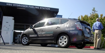 A hydrogen-powered Toyota Prius pulls up to Humboldt State University's student designed hydrogen fueling station.