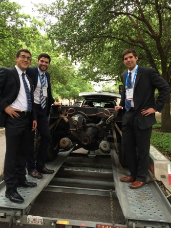 Mario Avila (left), Hayden Cardiff (center), and Thomas Healy of Hyliion have developed an add-on hybrid module for tractor trailers that is installed underneath the trailer and is estimated to have a fuel savings upwards of 30%. | <em>Photo courtesy of Hyliion</em>