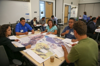 Workshop attendees reviewed renewable energy resource maps to identify the best sites for potential projects based on available resources. Photo by John De La Rosa, NREL