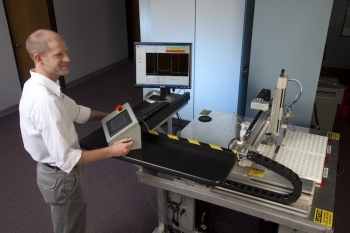 Application Engineer Eric Biedermann of Vibrant supervises an automated nondestructive testing system. | Photo courtesy of Sandia National Lab.