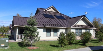 Energy-efficient homes in AHA's Sunrise Acres Complex include such features as rooftop solar domestic hot water. Photo from Akwesasne Housing Authority.