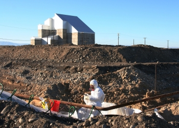 A worker cuts and drains pipe at a waste site in F Area. The pipe contained sodium dichromate, which was used as an anti-corrosion agent.