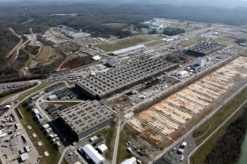Employees at Oak Ridge are accelerating work at K-25's East Wing. Sixty percent of the remaining structure is expected to be down by the end of the September.