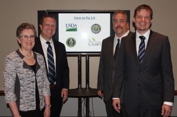 Catherine Woteki (from left), Under Secretary for Research, Education, and Economics, U.S. Department of Agriculture; David Danielson, Assistant Secretary for Energy Efficiency and Renewable Energy; Steve Csonka, Executive Director, Commercial Aviation Alternative Fuels Initiative; Jim Hileman, Chief Scientific and Technical Advisor for Environment, Federal Aviation Agency; stand together at Biomass 2014 in Washington, D.C., where the Energy Department announced it is joining Farm to Fly 2.0. | Energy Department photo