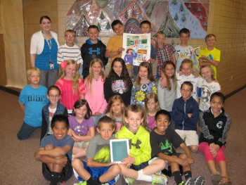 Students in the Nebo School District pose with the winning posters from a competition held by the Utah State Energy Program.  Photo courtesy of the National Energy Foundation