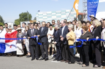 Secretary of Energy Ernest Moniz cuts the ceremonial ribbon to signal the start of U.S. Department of Energy Solar Decathlon 2015 in Irvine, California. | Photo by Matt Dozier, U.S. Department of Energy