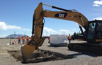 Workers excavate contaminated material at the French drains site.