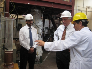 Ohio State University (OSU) Professor Liang-Shih Fan shows Assistant Secretary for Fossil Energy Charles McConnell OSU's coal direct chemical looping reactor. | Photo by Niranjani Deshpande