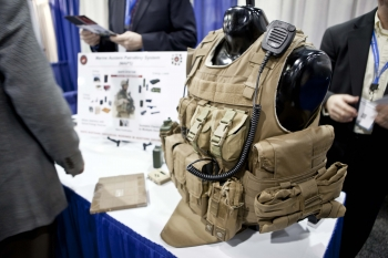 "At the 2013 ARPA-E Energy Innovation Summit Technology Showcase, the U.S. Marine Corps table featured a special vest with built-in solar cells, while the U.S. Army table highlighted a vest with a built-in fuel cell battery -- two ways to help efficiently power technology for American soldiers. | Photo by <a href=""/node/379579"">Sarah Gerrity</a>, Energy Department."