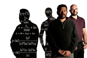 Metrologist Ibrahim Reda (left) and software developer Afshin Andreas developed the Solar Position Algorithm now used by solar trackers, orchard growers, and movie-camera makers. The algorithm used in the SPA appears in the shadow.   Photo by Dennis Schroeder/NREL.