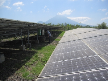 Solar photovoltaic power plant in rural Indonesia. EERE's project on Sustainable Energy for Remote Indonesian Grids (SERIG) conducted feasibility studies for generating electricity from renewable resources – including solar, wind, and biogas emitted from the process waste of mills that produce palm oil – to displace electricity generation from high-cost, imported diesel fuel in remote Indonesian communities. | Photo by Rob Sandoli