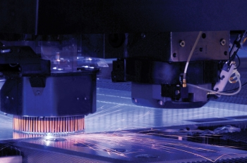 A combination solid-state laser turret cutter and stamping machine cuts a thin steel plate that will be formed into lighting fixture housing. Wisconsin-based Eaton Corporation is developing a new manufacturing process that streamlines LED fixture designs. | Photo courtesy of Eaton Corporation