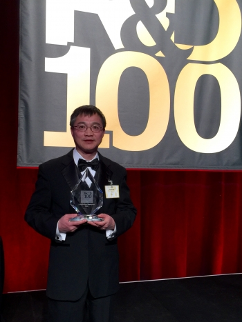 Dr. Jianping Yu, the lead researcher on the cyanobacterial bioethylene project, at the R&D 100 Award ceremony with the award. Photo courtesy NREL.