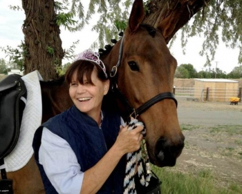 Shortly after arriving at Pacific Northwest National Laboratory, Dr. Kathy Hibbard purchased a young thoroughbred mare. Here, she is pictured at a birthday party thrown by her stable buddies.