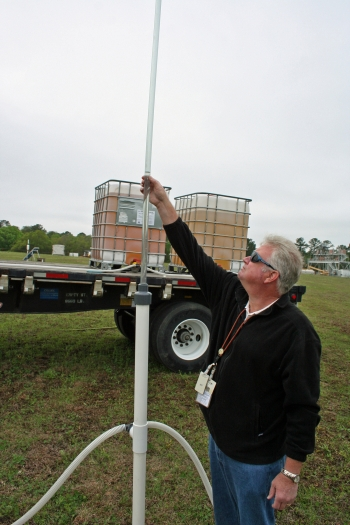 Savannah River Nuclear Solutions engineering and technical support specialist Keith Hyde measures the flow of vegetable oil during an injection process. The oil encourages growth of the underground population of naturally occurring, chemical-eating bacteria at the Savannah River Site.