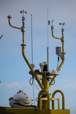 Meteorological instruments aboard the Energy Department's offshore wind power research buoys include anemometers (small white spinning cups on towers) and LiDAR (large white ball at bottom), among many others. These instruments provide data that will help improve offshore turbine performance and reduce barriers to investment in large-scale offshore wind energy development. Photo courtesy of Pacific Northwest National Laboratory.