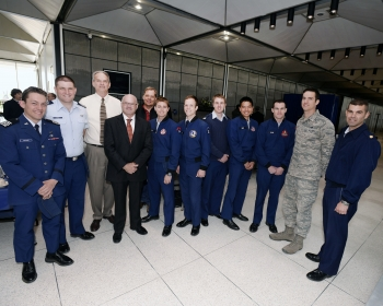 Federal Energy Management Program Director Dr. Timothy Unruh (fourth from left) with Air Force Academy staff and students. The Air Force Academy team won a DOE Excellence in Energy Award for their microgrid design that featured two biomass-fired combined heat & power facilities, fuel cells, and a complex load management scheme. |  Photo courtesy of Air Force Academy