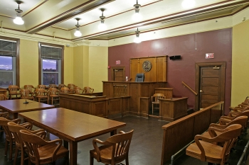 Franklin County Courthouse (After): The fully-restored main courtroom includes original 1930s paint colors and reproduction lighting.   Photo courtesy of Sallie Glaize