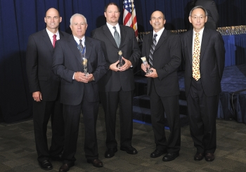 The Moab Uranium Mill Tailings Remedial Action Project Team with Secretary Steven Chu as they receive a Secretary of Energy Achievement Award. | Photo courtesy of the Energy Department