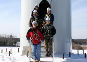 Mount Wachusett Community College staff Bill Swift, Bob LaBonte, Norm Boudreau, George Couillard and Vestas trainer Bill Fulkerson about to ascend the MWCC north wind turbine | Photo courtesy of GreenOnGreenStreet