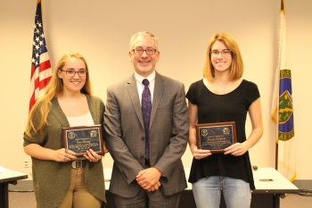 OREM Acting Manager Jay Mullis presented plaques of appreciation to ORSSAB student representatives Lara Manning, left, and Gabrielle McAllister.