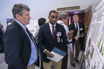 DOE Deputy Assistant Secretary Mark Gilbertson learns of research performed by South Carolina State student Andrew McCray