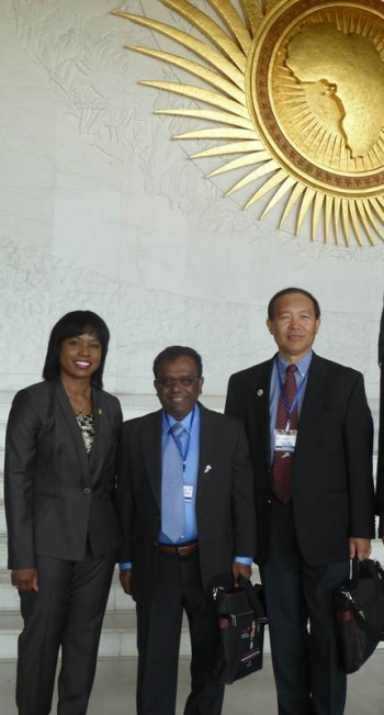 Director Dot Harris meets with Subramania I. Sritharan PhD, P.E., Central State University, and John J. Qu, Ph.D., George Mason University, fellow participants at the May 2014 U.S.-Africa Energy Ministerial in Ethiopia.