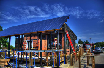 The Middlebury College team chose to design their house for its final placement in the team's hometown of Middlebury, Vermont. The result: The team created a Solar Path -- a walkway under the free-standing solar panels to the front of the house.   Photo courtesy of Middlebury College.