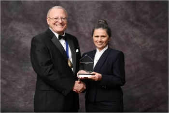 National EnergyTechnology Laboratory's Malgorzata Ziomek-Moroz (right) receives a 2013 Technical Achievement Award from NACE International, the Corrosion Society, for her accomplishments in the field of corrosion science.