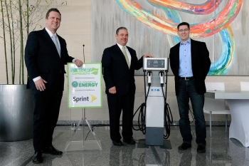 Assistant Secretary for Energy Efficiency and Renewable Energy David Danielson (from left); Mike Lynch, NASCAR Vice President of Green Innovation; and Darren Beck, Sprint Director of Environmental Initiatives stand next to a charging station at NASCAR's office in Charlotte, North Carolina. NASCAR and Sprint are now participating in the Workplace Charging Challenge. | Photo courtesy of NASCAR