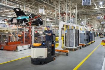 A worker drives a material handling train powered by hydrogen fuel cells at the BMW plant in Greer, South Carolina. The plant is home to the world's largest fleet of fuel cell forklifts. | Photo courtesy of BMW Manufacturing.