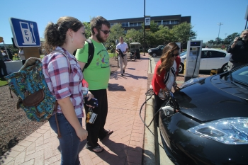 UNC Pembroke students look on as Ashley Fiala demonstrates how to charge a PEV. | Photo courtesy of Willis Glassgow, Campus Photographer, UNC Pembroke