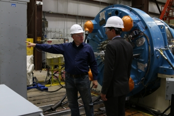 NREL researchers are completing testing of a next-generation drivetrain, shown here undergoing rigorous tests at the National Wind Technology Center's 2.5-megawatt dynamometer. NREL's testing validates the technology prior to commercialization. Shown here are NREL senior engineer and project lead Jonathan Keller (left) and DOE technology manager Nick Johnson. Photo by Malone Media.