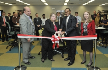 Peter O'Konski, Director for the Department's Office of Administration; Lauren Hall, Office of Administration; Mel Williams, Associate Deputy Secretary and Director of the Office of Management, Ingrid Kolb cut the ribbon on the new Headquarters Mobile Work Center.   Energy Department file photo, credit Ken Shipp.