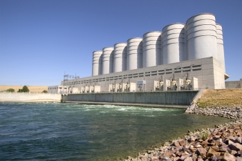 The Oahe Dam in South Dakota (pictured here) is one of the federal hydropower resources operated by the Western Area Power Administration. As part of a recent tribal leader dialogue, officials from the Energy Department, the Western Area Power Administration and South Dakota tribal leaders discussed ways to lower energy costs for tribes, including options for receiving federal hydroelectricity directly from the Western Area Power Administration instead of from third-party utilities. | Photo courtesy of South Dakota state government.