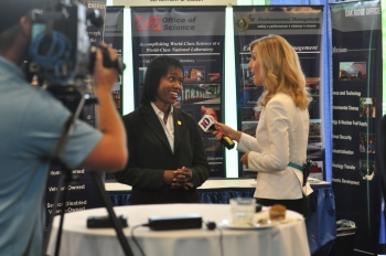 Dot Harris speaking live to WBIR, a local Knoxville television station, the morning of the Energy Department/National Nuclear Security Administration Small Business Summit (July 10). Photo: DOE Photographer Lynn Frenny