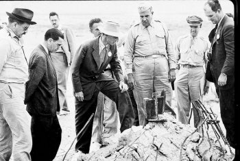 General Leslie Groves and J. Robert Oppenheimer are pictured here at the Trinity Test site in New Mexico, 1945.