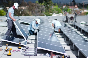 Installing a rooftop solar array as part of Los Angeles County's Feed-in Tariff program. | Photo courtesy of the Los Angeles Business Council.