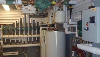 Geothermal and solar hot water heater control room at AHA's Sunrise Acres Complex. Photo from Akwesasne Housing Authority
