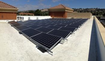 De-Meter's inaugural project for Tiburcio Vasquez Health Center in San Leandro, CA features a rooftop solar installation and carport. Photo courtesy of De-Meter.
