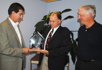 SRR Bubbler Project Manager Bill Pepper, center, accepts the PMI Project of the Year award from Eloy Saldivar, left, president of the Savannah River Chapter of PMI. DWPF Facility Manager Les Sonnenberg is on the right.