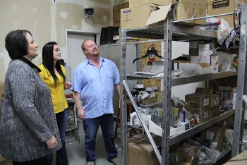 Fluor Idaho Procurement Manager Shawna Southwick, left, inspects inventory with Ashley Quiroz and Mike Hendrickson of Eagle Rock Specialties. The firm has provided outstanding support to Fluor Idaho.