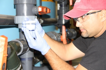 An operator tests the resin at a 100K Area pump-andtreat system to determine how much hexavelent chromium contamination it has gathered from the groundwater.