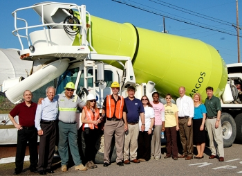 DOE and Savannah River Remediation team members gather in front of the first cement truck containing grout for Tank 18 at the Savannah River Site.