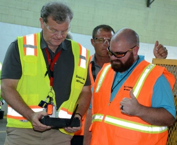 Fluor-BWXT Site Project Director Dennis Carr, left, learns how to operate a FirstLook robot from Fluor-BWXT Nondestructive Assay Engineer Kevin Banks.