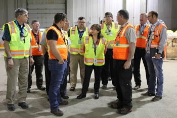 EM Assistant Secretary Monica Regalbuto, center, receives a briefing on EM's cleanup operations from Idaho Site employees.