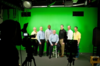 "Top executives from all major contractors at the Savannah River Site and DOE Savannah River Operations Office Manager David Moody (seated) work together to create a video production promoting the ""Safety Begins with Me"" program."