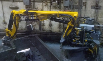 A newly installed robotic arm is at work.