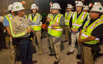Waste Isolation Pilot Plant employees discuss waste emplacement operations with Energy Secretary Rick Perry, center, while inside the facility 2,150 feet underground.