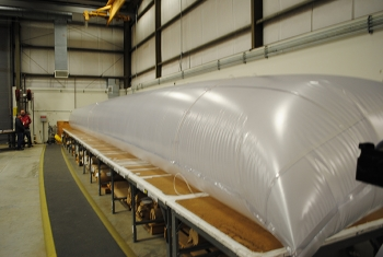 Workers at the Containment Fabrication Facility created an engineered equipment removal sleeve for elevated wind speed applications.